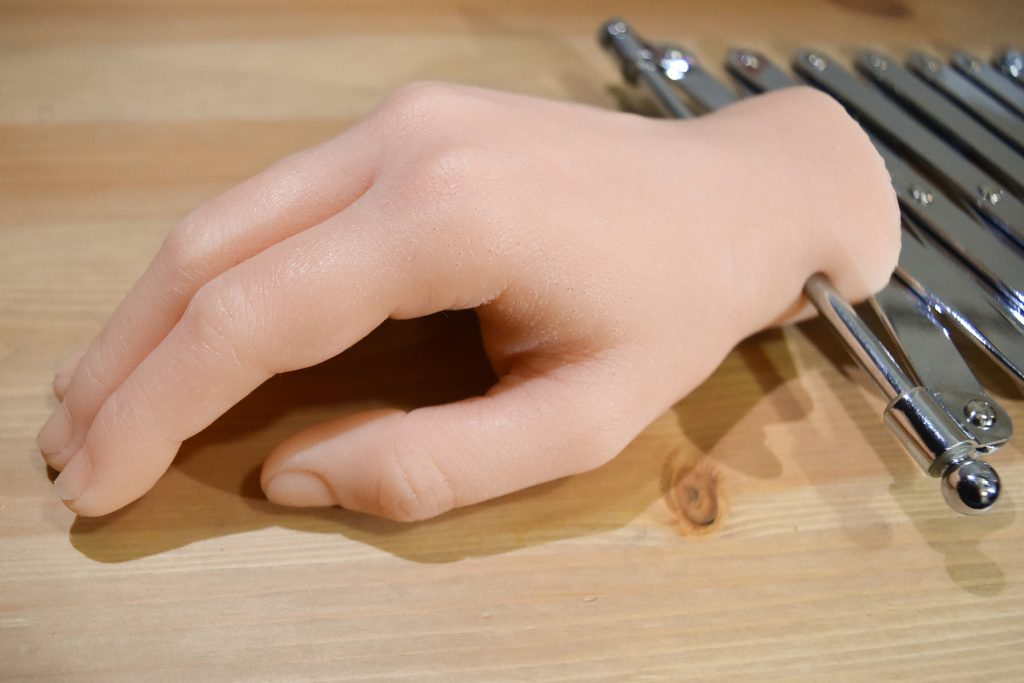 The Handshaker TM, Natalie Cheatham, silicone cast of human hand, steel, rubber grips