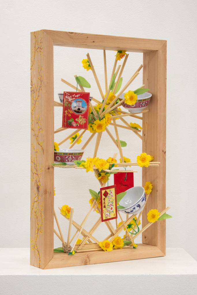 New Years in a Box - Diana Tran, wood, chopsticks, paint markers, twine, plastic bowls, red envelopes, plastic cherry blossoms