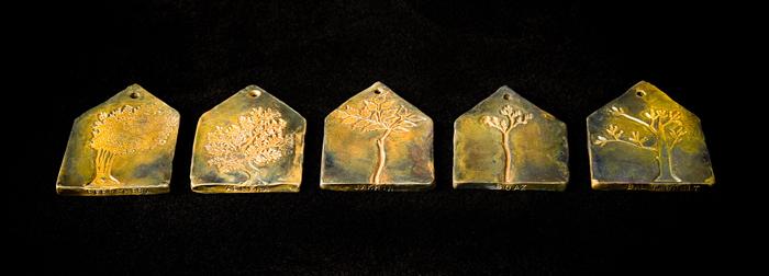 Tree Amulets; Beth Krensky, 2007, bronze, (5) each 5 x 3-1/2 x 1/4