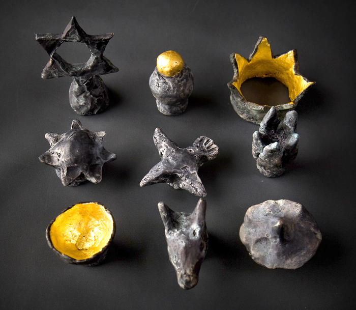 Finials; Beth Krensky, 2007, bronze and gold leaf, (14) each approx. 2 x 2 x 1-1/2