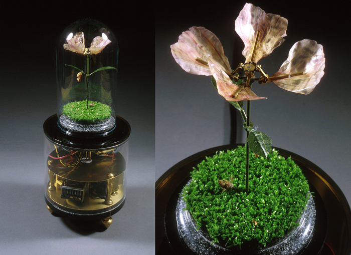 New American Landscape; Paul Stout, plastic casing with a glass top enclosing a flower, Astroturf, a butterfly chrysalis, and brass, steel and aluminum parts, H: 15