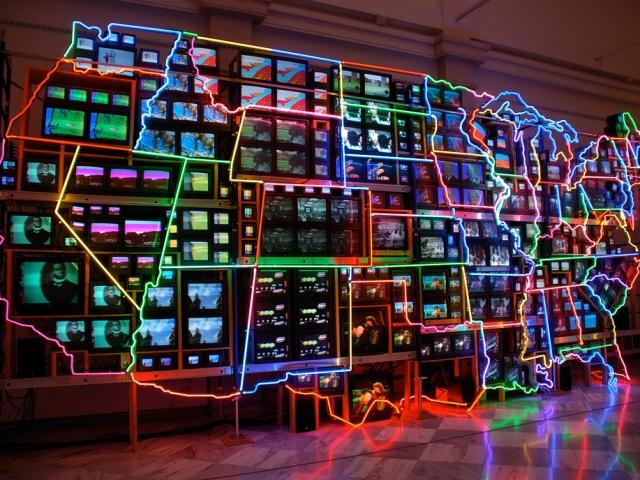Electronic Superhighway; Nam June Paik, 1995 CE, TV monitors, laser disc images, neon, 15 x 32'