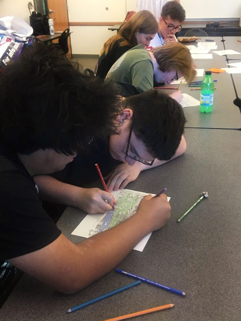 High school students composing color palettes for the murals