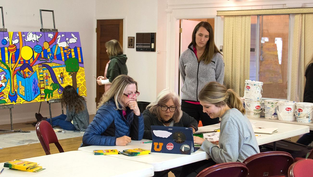 Discussing a mural design