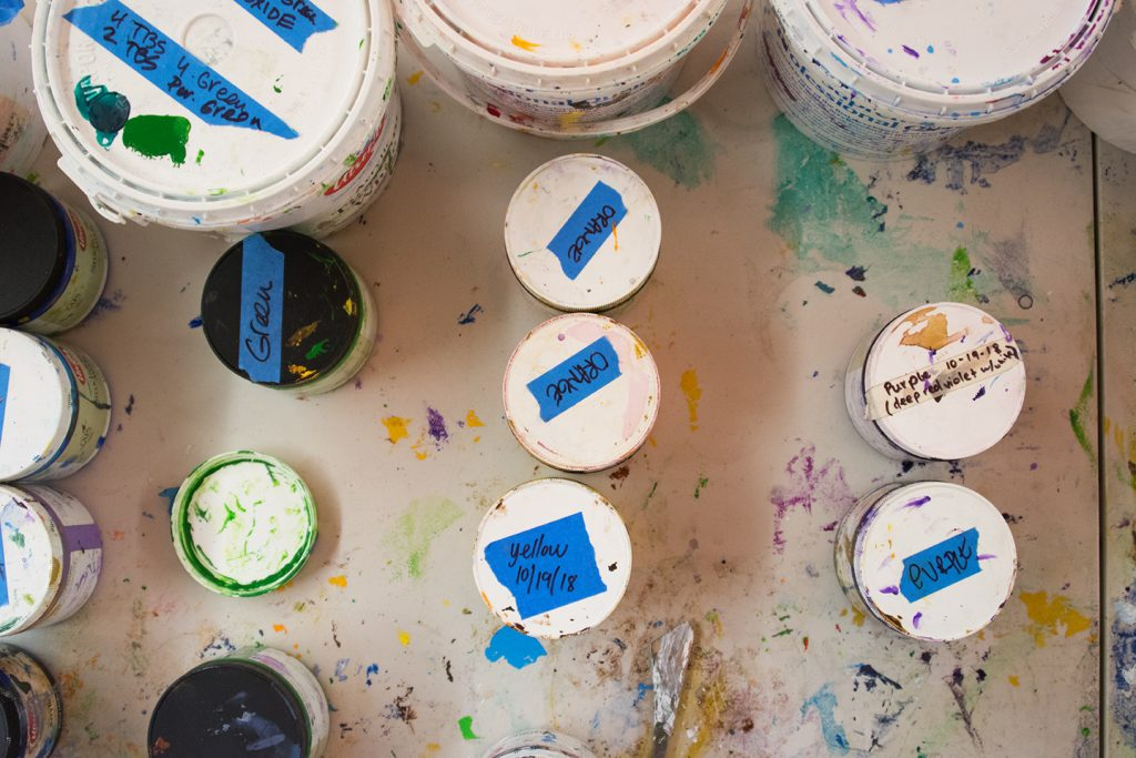 Various sizes of mural paint containers