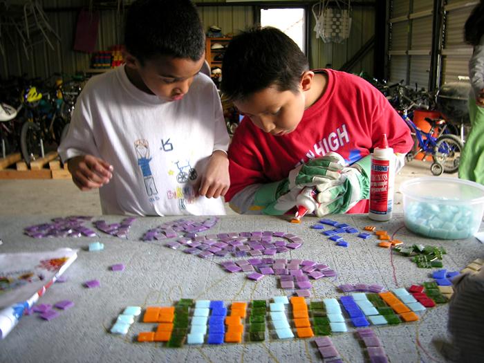 Neighborhood House youth creating mosaic