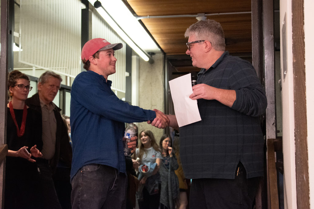 Annual Student Exhibition Opening Reception: Department Chair Paul Stout presents the Rolapp award to Nikita Nenashev
