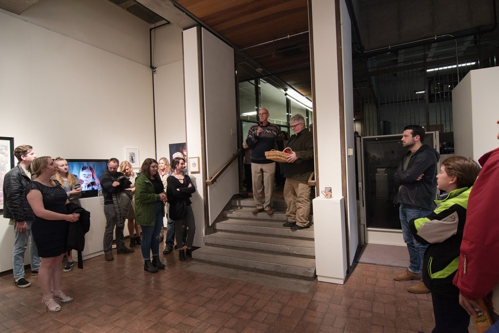 Annual Student Exhibition, 2018: Opening Reception; Whit Hollis, director of the A. Ray Olpin Student Union, announced the Union purchase award winner Leah Caldwell