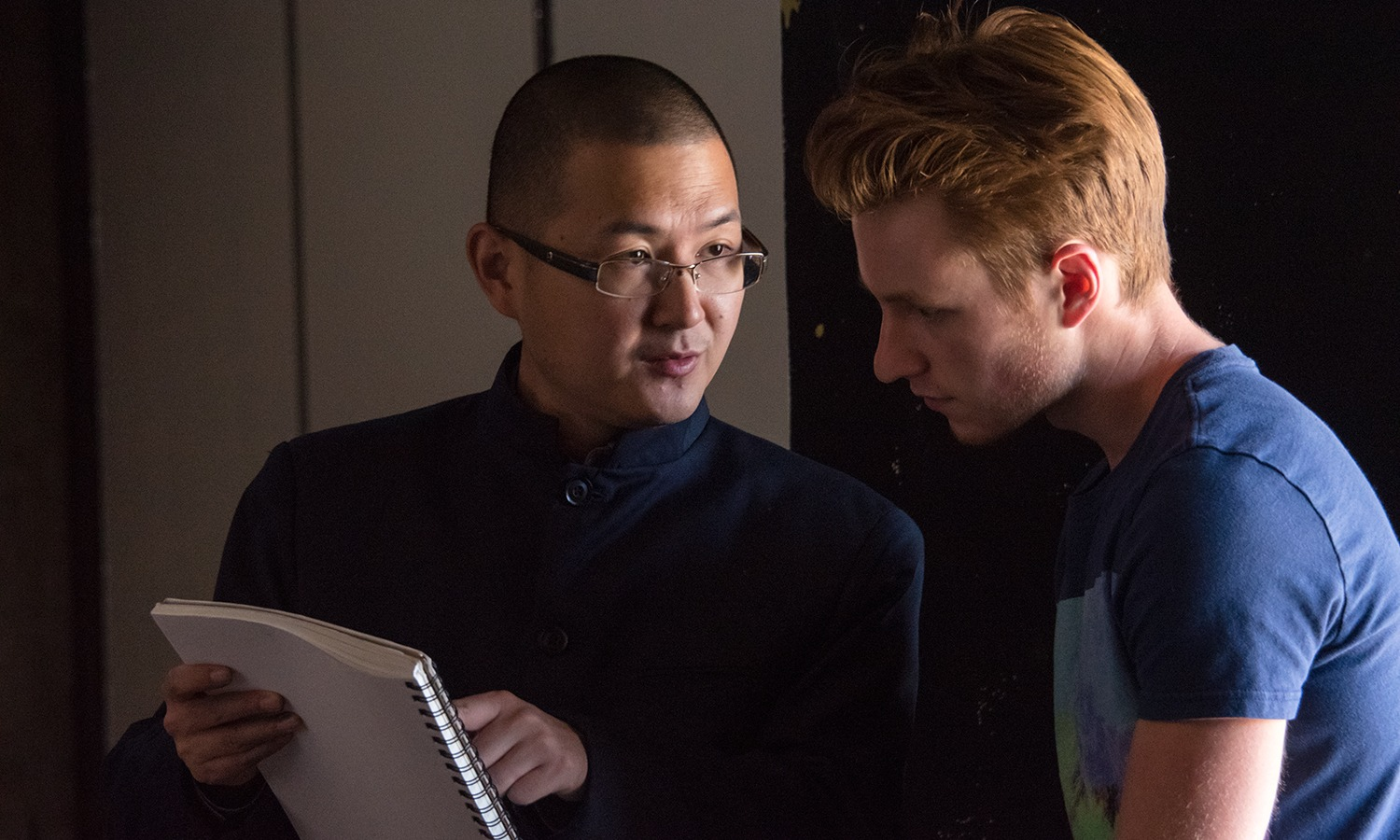 Professor Xi Zhang works with a student
