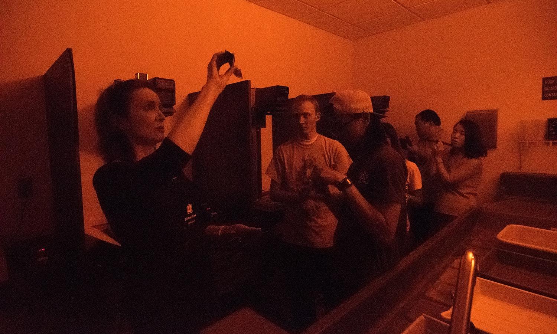Professor Laurel Caryn in class in the darkroom