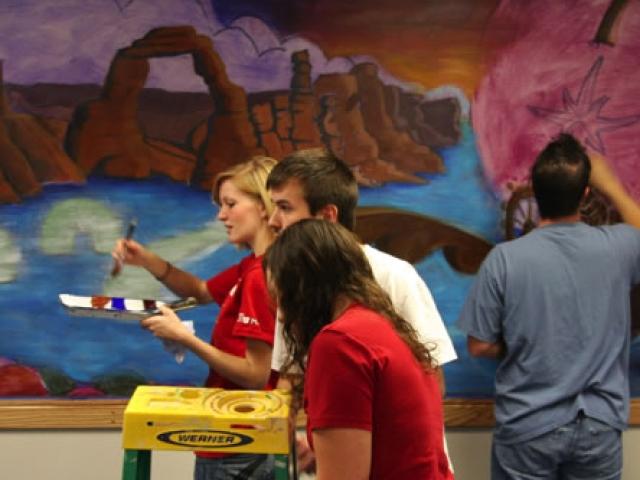 Murals students working